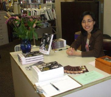 author signing a book